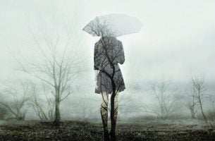 sad woman sillouete with umbrella
