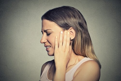 Woman with ear problems