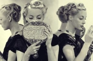 Woman looking in mirror displaying narcissism