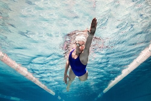Woman swimming in pool