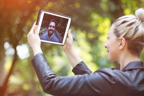 A woman making video calls with her boyfriend promotes communication.
