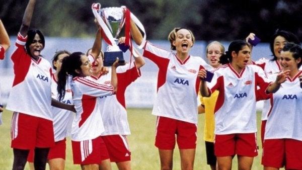 Girls winning a trophy.