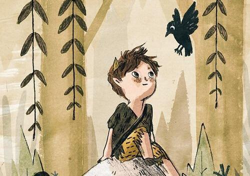 Boy smiling while looking at a crow.