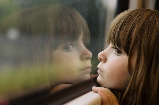 Child looking out the window.