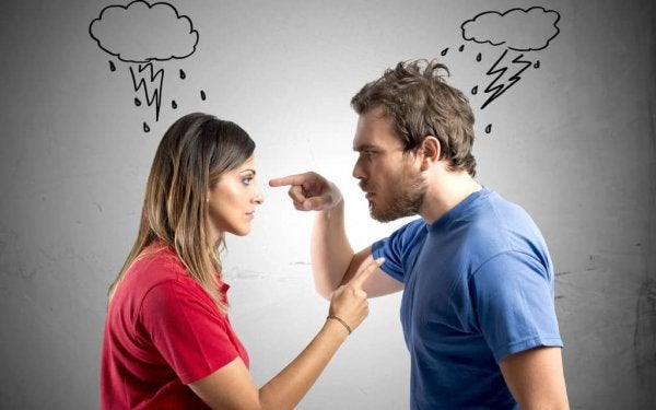 A couple immersed in an argument where one feels superior over the other.