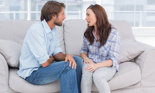 A couple talking about their problems is a way to assert your needs without blaming your partner.