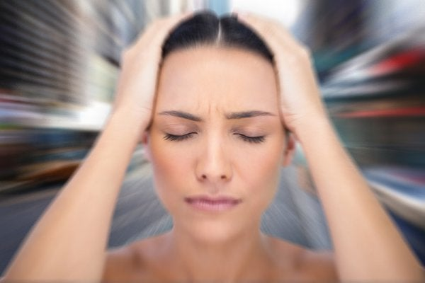 Woman dealing with frequent dizziness from her anxiety.