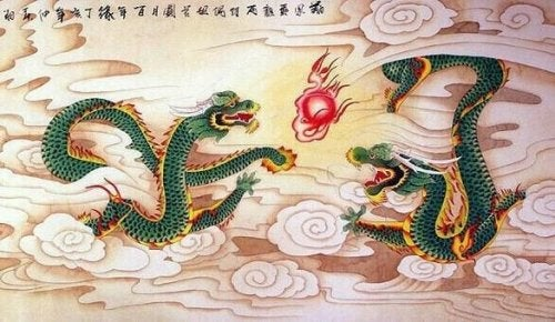 Two green dragons breathing fire.