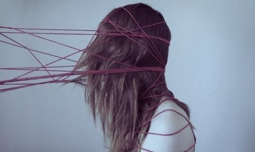Cognitive biases wrapping a girl's head like threads.