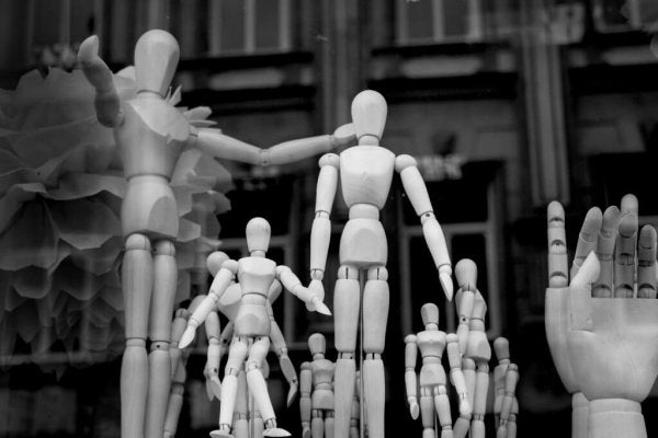 A group of wooden dolls represents the goodness of man.