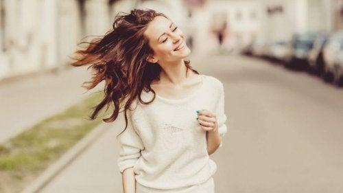 Woman smiling while walking.