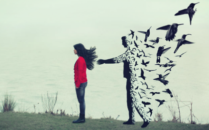 Man fading into birds.