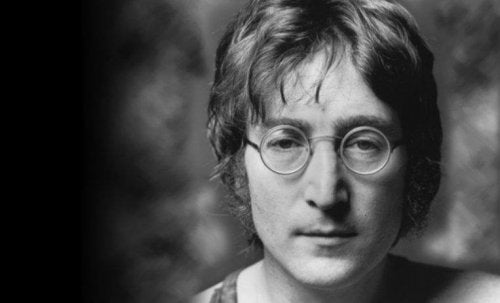 Black and white portrait of John Lennon.