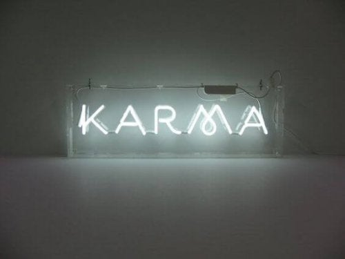 Sign that lights up that says karma.