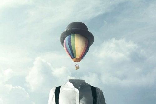 Man with hot air balloon head understanding social sciences.