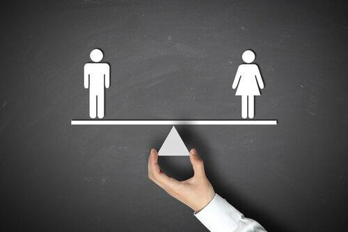Man and woman on a scale in the absence of gender inequality.