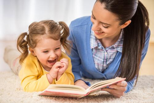 Mother and daughter reading together.
