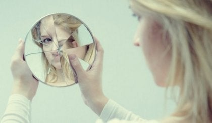 Woman looking in a broken mirror.