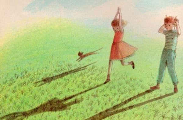 Girl playing in the grass.
