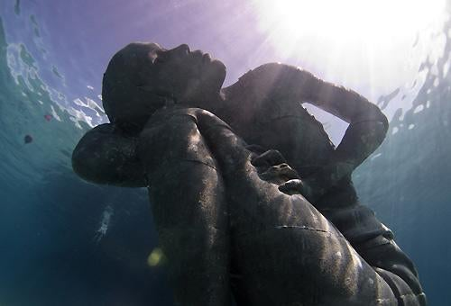 A sculpture by Jason deCaires Taylor.