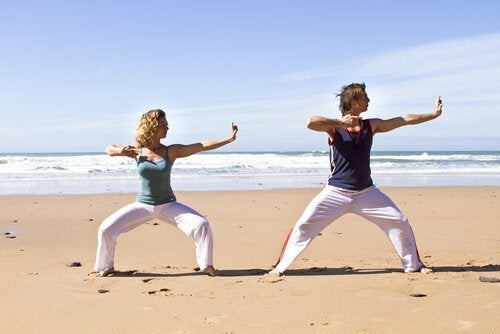 People doing qigong on the beach.