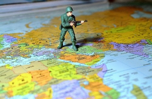 A soldier on a world map.
