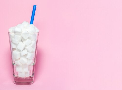 A glass full of sugar cubes.