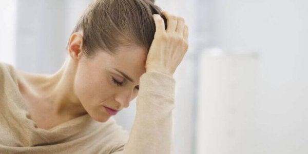 woman headache time change