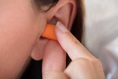 A woman who uses earplugs to sleep.