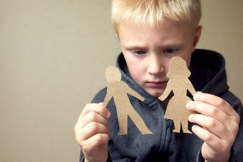 Boy looking at mom and dad cardboard figures.
