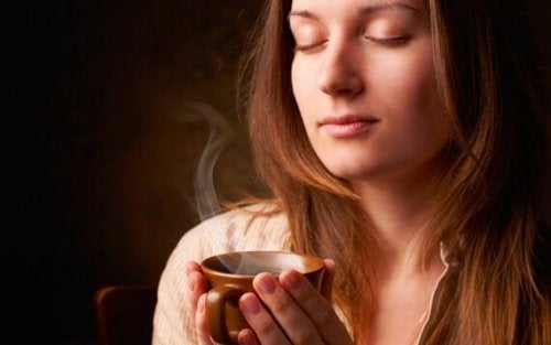 Woman smelling coffee.