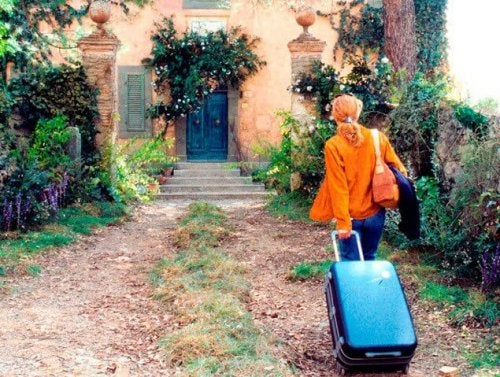 Starting over after a divorce: Frances with a suitcase entering an abandoned villa.
