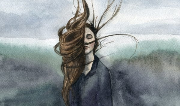 A girl with her hair in the wind.