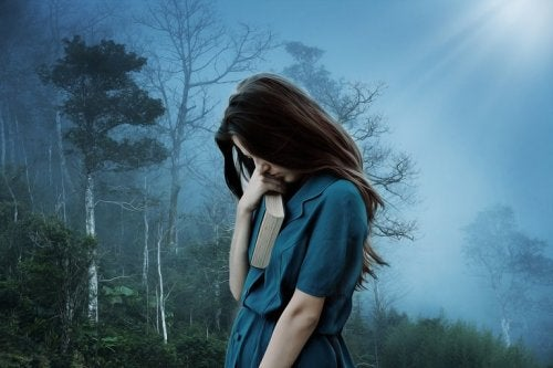 A woman with depression in the forest.