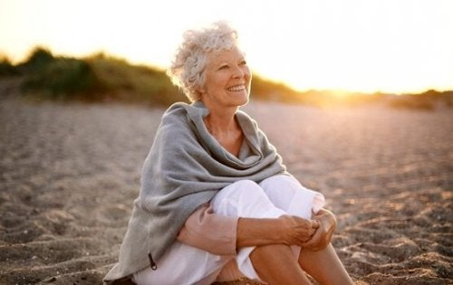 Happy senior woman on the beach.