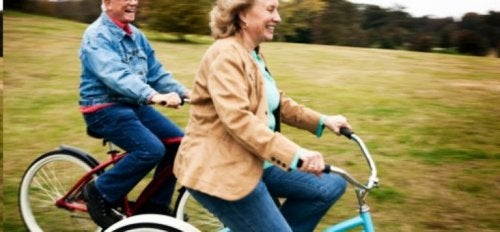 Two seniors riding bikes.