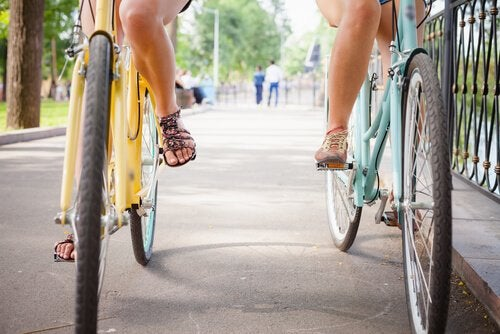 Two friends riding their bikes.