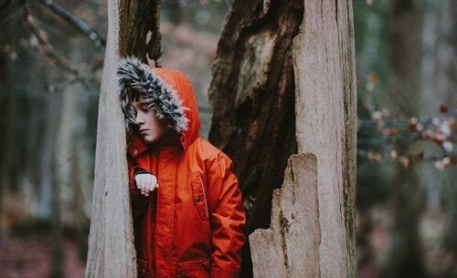 Boy in red jacket with emotionally negligent family
