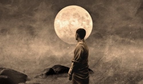 Buddhist monk in front of the moon.