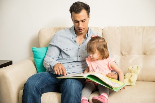 father reading with his daughter