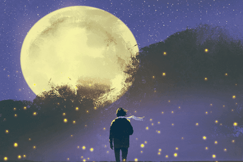 A guy with a scarf looking at the moon.