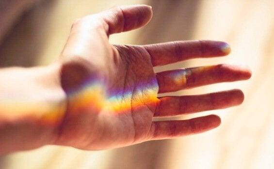 Hand with beam of light.