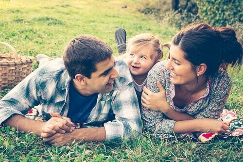 Happy family lying on grass.
