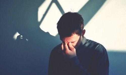 Man sad from compassion fatigue.