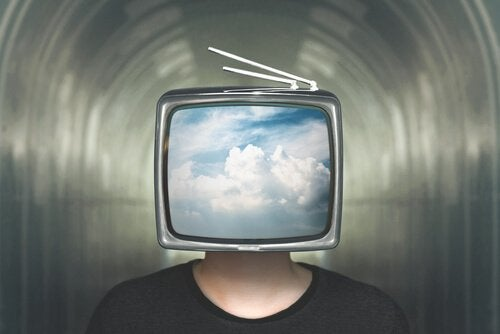A man with a TV on his head.