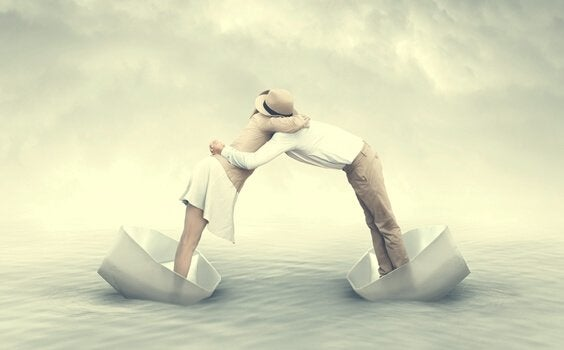 Two people embracing from different boats.