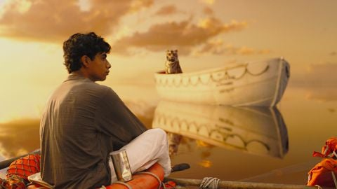 Pi with tiger in the ocean in Life of Pi.