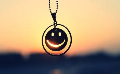 Smiley face necklace.