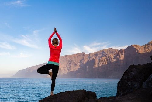Woman doing tree pose.