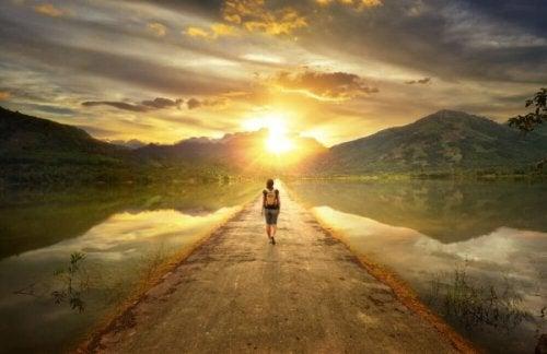 Woman walking towards the mountains.
